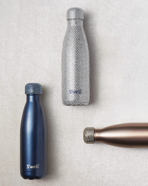 Glimmering S'well bottles from the Brilliance collection, covered in 6,000 Swarovski crystals.