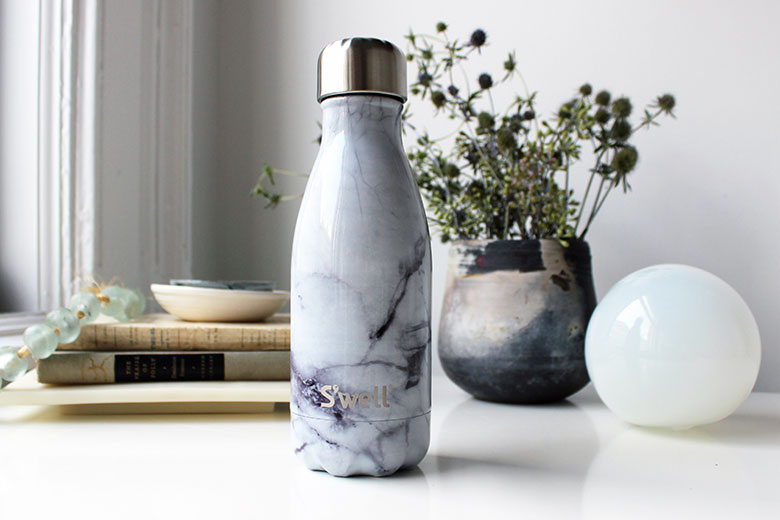 S'well water bottle doubles as a decorative object, suitable for any desk or end table arrangement.-copy