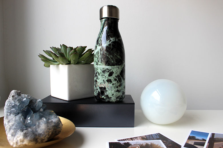 S'well water bottle doubles as a decorative object, suitable for any desk or end table arrangement.